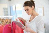 Shop woman preparing summer sales in store