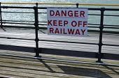 stock photo of railroad-sign  - Warning danger sign informing that you should keep off the railway due to risk of injury or death - JPG