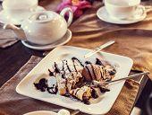 foto of fancy cake  - Sweet cake with ice cream in the fancy cafe - JPG