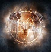 picture of pentagram  - Two hooded figures and a demonic ram skull materialising within a fiery pentagram of mysterious occult symbols suggesting a black mass or magic ritual - JPG