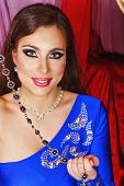stock photo of harem  - Young oriental beauty holding jewelry - JPG
