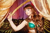 stock photo of harem  - Sexy oriental beauty holds in her hands sword of Damascus steel - JPG