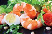 pic of tiger prawn  - Salad of king prawns and rukola in a black plate - JPG