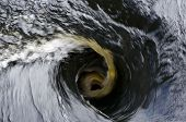 pic of upstream  - Water swirl upstream a open floodgate picture from the North of Sweden - JPG