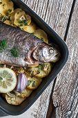 picture of baked potato  - Baked trout with potatoes and onions sprinkled with parsley - JPG
