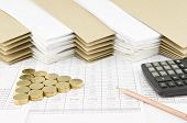 foto of piles  - Brown pencil and pile of gold coins as triangle with calculator on finance account have pile of paperwork with envelope as background - JPG