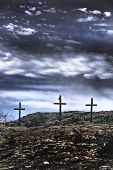 stock photo of inri  - The three old wooden crosses on the hill - JPG