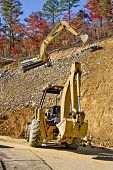 stock photo of earthwork operations  - Vertical shot of an excavator at an industrial site - JPG