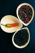 foto of peppercorns  - closeup green chilli peppers and different types of peppercorns - JPG