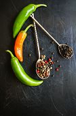stock photo of peppercorns  - closeup green chilli peppers and different types of peppercorns - JPG