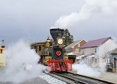 stock photo of locomotive  - A steam locomotive preparing to leave the station - JPG
