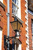 image of wrought iron  - Wrought iron lantern on the wall of a building in The Square Shrewsbury Shropshire England UK Western Europe - JPG