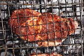 foto of charcoal  - grilled roast meats beef lamb fillet ribs on bbq grid over charcoal - JPG