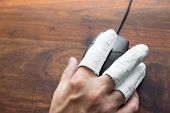 picture of handicap  - a hand with PC mouse concept incapacitated handicap