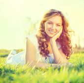 pic of grassland  - Beauty Fresh Romantic Girl lying on summer field Outdoors - JPG