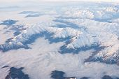 stock photo of andes  - Andes mountains cloudy from the sky - aerial view