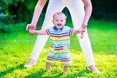 image of children walking  - Baby boy making his first steps - JPG