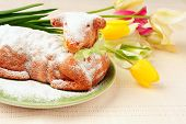 stock photo of spring lambs  - traditionel Easter lamb cake and colorful tulips - JPG