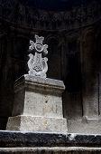 image of armenia  - Hall of ancient christian rock temple Geghard with a ornamental stone cross Armenia - JPG