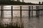 stock photo of south-western  - Silhouette of a jetty in a dam near Somerset West in the Western Cape Province of South Africa - JPG