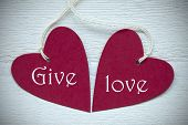 picture of two hearts  - Two Red Hearts Label Or Tag With White Ribbon On White Wooden Background With English Text Give Love Vintage Retro Or Rustic Style With Frame - JPG