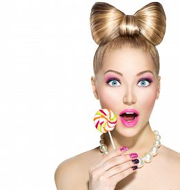 stock photo of lollipops  - Beauty fashion model girl Eating colourful lollipop - JPG