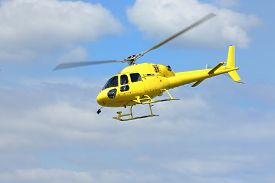picture of helicopters  - Helicopter rescue Yellow helicopter in the air while flying on blue sky - JPG
