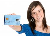picture of debit card  - beautiful casual girl holding a business card over a credit card - JPG