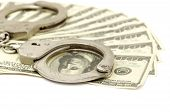 foto of snitch  - Handcuffs on money background - JPG