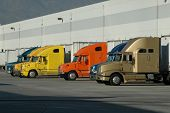 stock photo of loading dock  - diesel trucks at warehouse loading docks in california - JPG