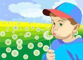 a little boy blowing on a dandelion in the meadow