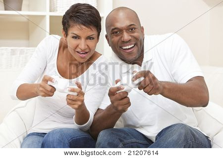 poster of African American couple, man and woman, having fun playing video console games together.