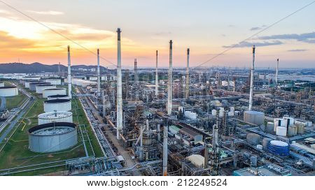 poster of Aerial view Oil refinery.Industrial view at oil refinery plant form industry zone with sunrise and cloudy sky.Oil refinery and Petrochemical plant at duskThailand. Oil refinery background sunset.