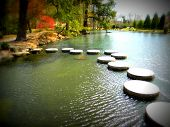 stock photo of stepping stones  - Body of water with stepping stones in Japanese Garden - JPG