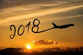 New year 2018 drawing by airplane on the air at sunset poster