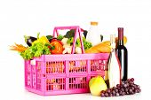 food basket with vegetables, bread and wine isolated on white