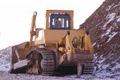 Heavy bulldozer in open pit