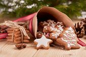 Christmas gingerbreads. Christmas decorations. Handmade cookies in paper cone  lying on the wooden t poster