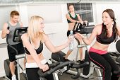 Fitness Young Girl On Gym Bike