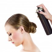 stock photo of hairspray  - Hairdresser fixing woman hair with hairspray - JPG
