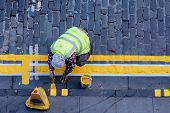 Workman Line Painting Cobbled Street