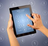 Female fingers touching tablet with locked device requiring passcode poster