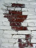 foto of arsenic  - Brick Wall With Some White Paint and Some Red Brick - JPG