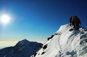 stock photo of winter sport  - Group of mountaineers climbing a mountain Ridge west Alps - JPG