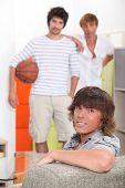 Guys waiting to play basketball