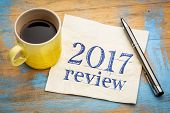 2017 review text on a napkin with coffee against grunge wood desk poster