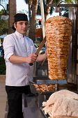 Chef slicing Turkish doner kebab