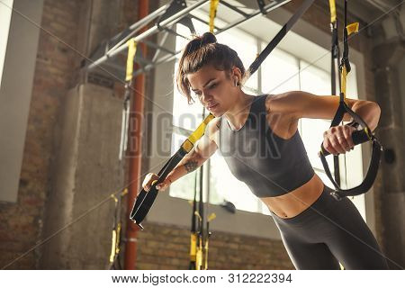 poster of Perfect Push-up. Side View Of Young Athletic Woman With Perfect Body In Sportswear Doing Push Ups Wi
