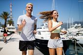 Couple Jogging And Running Outdoors In Nature. Sport Concept poster