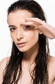Beautiful Wet Nude Young Woman With Hand Near Face Looking At Camera Isolated On White poster